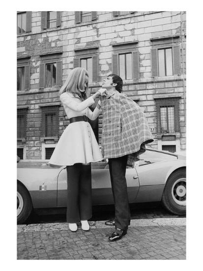 Vogue - April 1969 - Veruschka Adjusts Tomas Milian's Cape-Franco Rubartelli-Premium Photographic Print