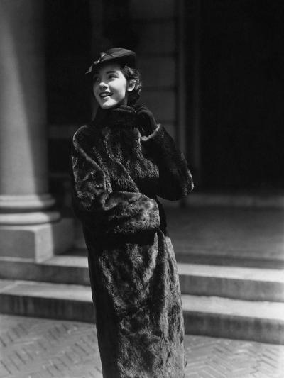 Vogue - August 1934 - Young Woman in Nurtria Fur Coat-Lusha Nelson-Premium Photographic Print