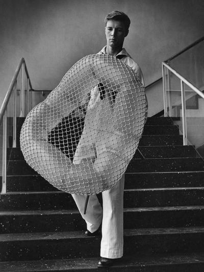 Vogue - July 1944 - William Miller Carrying a Chair he Designed-Karger-Pix-Premium Photographic Print