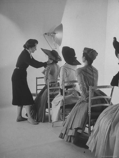 Vogue Magazine Editor Bettina Ballard Directing and prepping models for Photo Shoot at Studio-Nat Farbman-Premium Photographic Print