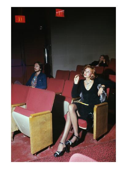 Vogue - September 1972 - Woman in Movie Theater-Kourken Pakchanian-Premium Photographic Print
