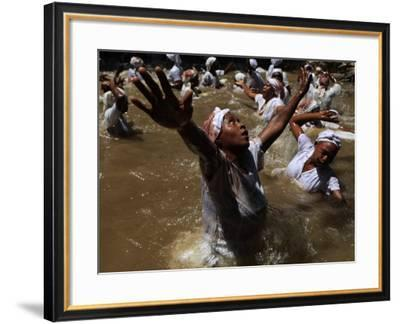 Voodoo Believers Perform a Ceremony at a Sacred Pool in Souvenance, Haiti--Framed Photographic Print
