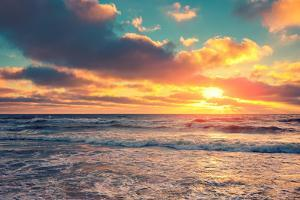 Sea Shore at Sunset with Cloudy Sky by vvvita