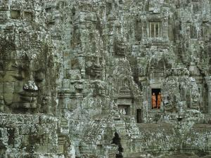 Buddhist Monks in a Doorway of the Ruins of the Bayon at Angkor by W^ E^ Garrett