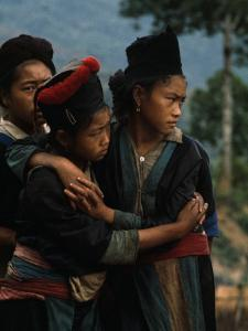 Hmong Girls Cling to Each Other During Social Unrest by W.E. Garrett