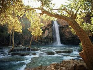 Scenic Waterfall Framed by Trees by W.E. Garrett