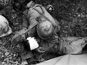 American Soldier Comforting Wounded Comrade During Fight to Take Saiapn from Japanese Troops by W. Eugene Smith