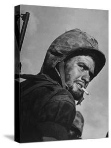 Battle Weary, Cigarette Smoking Marine on Saipan During Fight to Wrest the Island from Japanese by W. Eugene Smith