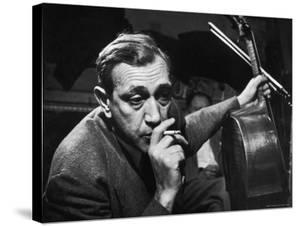 Candid of Cellist Gregor Piatigorsky in RCA Victor Studio Recording a Piece by Brahms by W. Eugene Smith