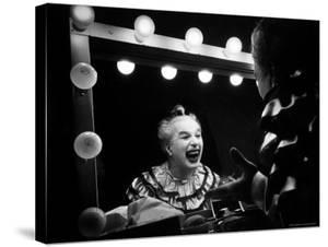 Charlie Chaplin at Dressing Room Mirror, Giving Himself a Wide Grin by W. Eugene Smith