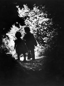 Children of Photographer with Eugene Smith Walking Hand in Hand in Woods Behind His Home by W^ Eugene Smith