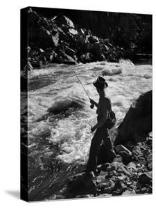 Country Dr. Ernest Ceriani Casting into Colorado River to Catch a Few Trout by W. Eugene Smith