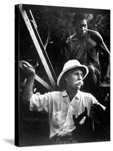 Dr. Albert Schweitzer, Medical Missionary and Humanitarian, with Carpenter at Site of His Hospital by W. Eugene Smith