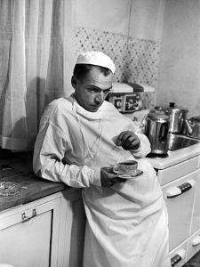 Dr. Ernest Ceriani in a State of Exhaustion, Having a Cup of Coffee in the Hospital Kitchen at 2 AM by W. Eugene Smith