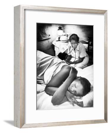Famous Midwife-Nurse Maude Callen, Attending a Woman in Labor
