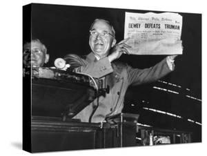 "Harry Truman Jubilantly Displaying Erroneous Chicago Daily Tribune Headline ""Dewey Defeats Truman"" by W. Eugene Smith"