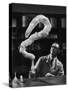 Leaping Rubber Explosively from Butadiene Gas in Bottle as Demonstrated by M.I.T.'s Dr. A. Morton by W. Eugene Smith