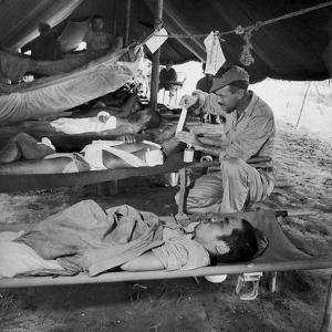 Lew Ayres Treating Wounded Japanese Prisoner in Leyte Cathederal Turned into Hospital, 1944 by W. Eugene Smith