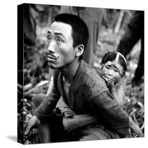Marianas Island Father with Child After Capture by Americans During Battle Between US and Japanese by W. Eugene Smith