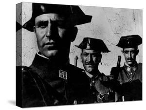 """Members of Dictator Franco's Feared Guardia Civil in Rural Spain, from Essay """"Spanish Village."""" by W. Eugene Smith"""
