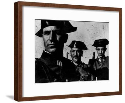 "Members of Dictator Franco's Feared Guardia Civil in Rural Spain, from Essay ""Spanish Village."""