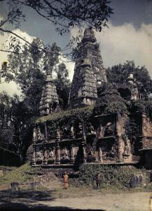 """Buddah-Adorned """"Temple of Seven Peaks"""" Stands, Decayed over Time by W. Robert Moore"""