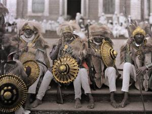 Ethiopia's Veterans, in Traditional Costumes, Sit on Cathedral Steps by W. Robert Moore