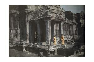 Two Members of the Buddhist Clergy Stand at the Door of Angkor Wat by W. Robert Moore