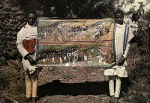 Two Men Hold a Painting That Symbolizes Makeda's Visit to Solomon by W. Robert Moore