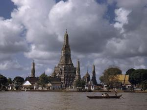 Wat Arun Temple Towers over the Muddy Waters of the Chao Phraya by W. Robert Moore