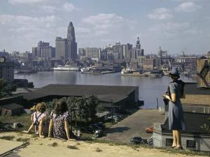 Women Look at Baltimore's Downtown from across the Patapsco River by W. Robert Moore