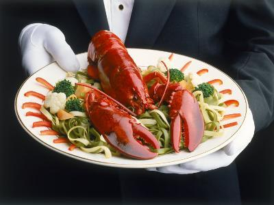 Waiter Serving Plate of Lobster-Howard Sokol-Photographic Print