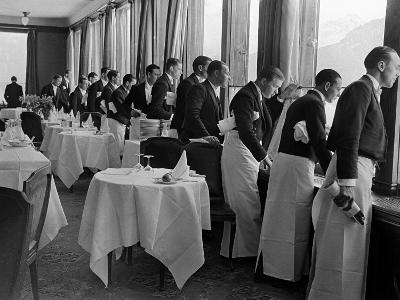 Waiters at the Grand Hotel Line Up at the Windows to Watch Sonja Henie Ice Skate Outside-Alfred Eisenstaedt-Photographic Print