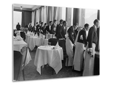 Waiters in the Grand Hotel Dining Room Lined Up at Window Watching Sonja Henie Ice Skating Outside-Alfred Eisenstaedt-Metal Print