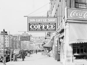 Downtown street in New Orleans, Louisiana, 1935 by Walker Evans