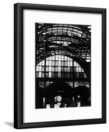 Features of NYC Penn Station Include Ceiling of atrium, steel glass Vaulting and Decorated Clock.