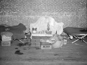 Goods of a person in the Red Cross infirmary for flood refugees at Forrest City, Arkansas, 1937 by Walker Evans