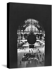 Interior of Penn Station Through Archway and Behind Suspended Clock, with Ceiling Ironwork by Walker Evans