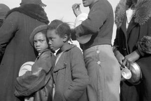 Lining up for food at mealtime in the camp for flood refugees, Forrest City, Arkansas, 1937 by Walker Evans