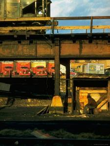 Moody Sunlight Showing Arty Grouping of Hopper Car, Rusting Elevated Span, Trucks, Etc by Walker Evans