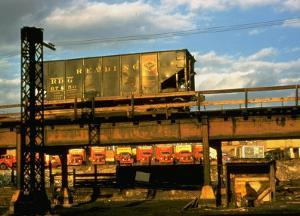 Moody Sunlight Showing Hopper Car of the Reading Railroad Idle on Rusting Elevated Span by Walker Evans