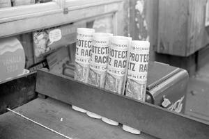 Newspapers for sale at a grocery, 324 East 61st Street, New York City, 1938 by Walker Evans