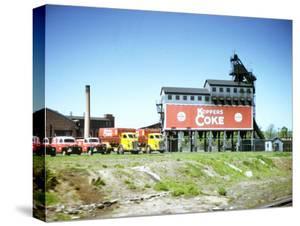 Photo Taken from Window of a Train Showing Coke Processing Plant Near Tracks by Walker Evans