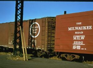 Railroad Box Cars with the Logos of the Atlantic Coast Line and Milwaukee Road Railroads by Walker Evans