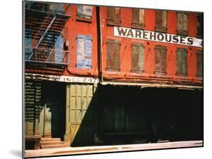 Shuttered Warehouse on the Lower East Side Lit by Late Day Sunlight by Walker Evans