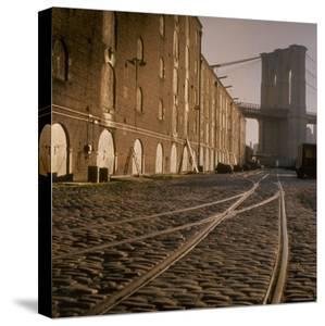 Shuttered Warehouses Lit by Sunlight on Trolley Track Railed Street Along Brooklyn Waterfront by Walker Evans