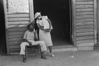 Sidewalk scene in Alabama, 1936