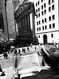 Wall Street Journal Reader across the Street from the New York Stock Exchange Building