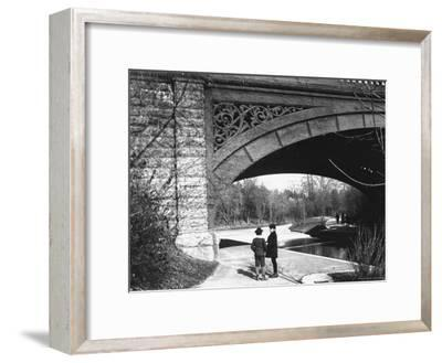 Two Boys Standing under the Ornate Arch of a Bridge in Prospect Park, Brooklyn, Ny