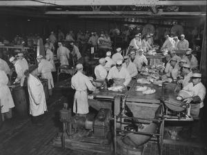 1946: Workers as They Butcher Meats in the Hormel Foods Corporation Factory, Austin, Minnesota by Wallace Kirkland